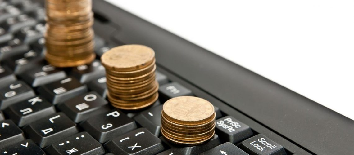 Line of coins on black computer keyboard. Isolated on white, Image: 102607756, License: Royalty-free, Restrictions: , Model Release: no, Credit line: Profimedia, Alamy