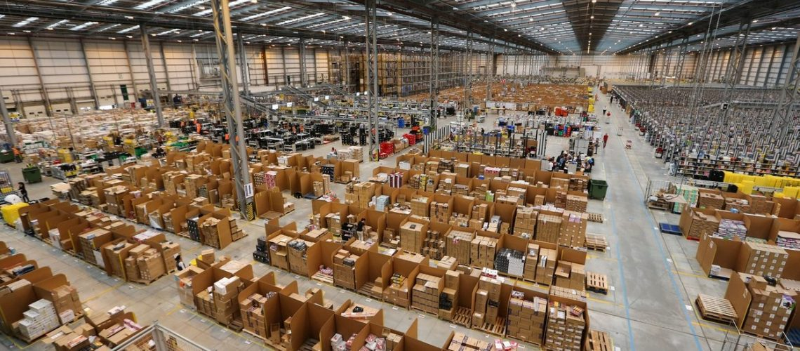 THE AMAZON WAREHOUSE IN PETERBOROUGH,CAMBS,ON THURSDAY NOV 7TH 2013.THE WAREHOUSE IS ABOUT TO HIT ITS  BUSIEST TIME  TO  THE BUILD UP TO CHRISTMAS AND COMPANY HAS EMPLOYED 50% EXTRA STAFF COMPARED TO LAST YEAR.Shopping website Amazon has increased its seasonal workforce by 50 PER CENT this Christmas to deal with the high demand from customers.The online retailer has hired more than 15,000 seasonal workers this year - a massive 5,000 more than in 2012.Staff at Amazon are already working flat out in its UK warehouses as orders pour in with less than 50 shopping days to Christmas.Workers at the Peterborough fulfilment centre in Cambridgeshire are picking and packing round the clock as millions begin their online Christmas shopping.Amazon predicts that the busiest day for online shopping in the UK, often referred to as Cyber Monday, will fall on December 2 this year, with post-work Christmas shoppers triggering a sales peak at 6pm.,Image: 176497203, License: Rights-managed, Restrictions: , Model Release: no