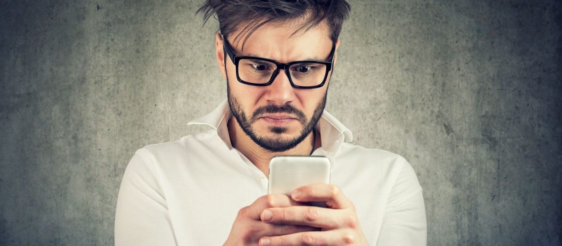 stunned man, surprised offended, shocked by what he sees on his smartphone, Image: 384196944, License: Royalty-free, Restrictions: , Model Release: yes, Credit line: Profimedia, Stock Budget